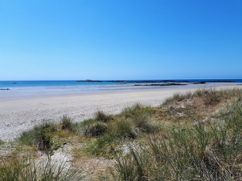 The image shows Crigyll Beach taken from the top of the sand dunes to the rear in summertime