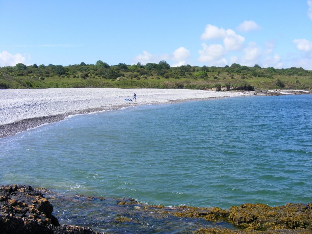A picture of the shingle beach at Penmon Point taken form the rocky outcrop next to the lighthouse